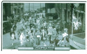 mm29. Procession passing the Clothiers celebrating WW2 Victory 1945.