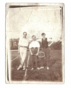 Tennis court with Harold Wimpenny ? holding the racket.