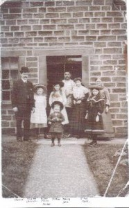 A family photograph of the Sandersons in 1907 in their house opposite the Zion Church with a very young Arthur in the front.